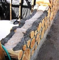 Cordwood wall with insulation between inside and outside mortar