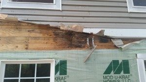 Picture of porch roof to wall flashing damage