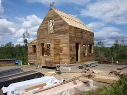 Picture of home under construction using board sheathing