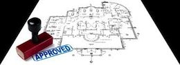 Picture of building plans with stamp of approval