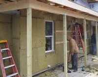 Image of mineral wool as board sheathing for building under construction
