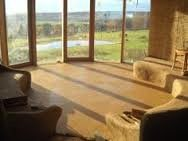 Picture of Cob floor slab with sunshine as a cost-effective thermal mass.