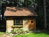 Picture of small cordwood home
